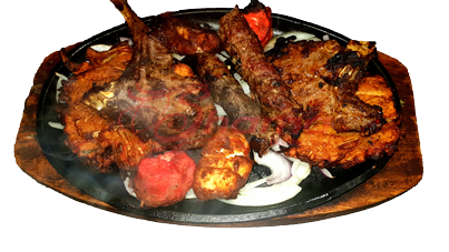 Our Mixed Sizzler for Two contains Onion Bhaji, Lamb Chops, Seekh Kebabs, Chicken Tikka and Fish Masala!